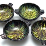 Party ashtrays made by Italian glass makers of the 1960's. Beautiful black glass with copper aventurine and green and gold inclusions.
