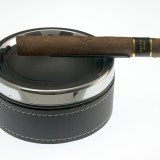 Metal floating ramp cigar ashtray features built-in rest hovering well above ash receiver. The floating ramp rest can accommodate cigars or cigarettes.