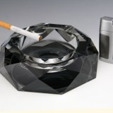 Large black crystal ashtray with diamond faucet decor and beveled edges. Four rests fits cigarettes and smaller.