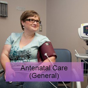 Woman sat having her blood pressure taken - antenatal care research and guidelines