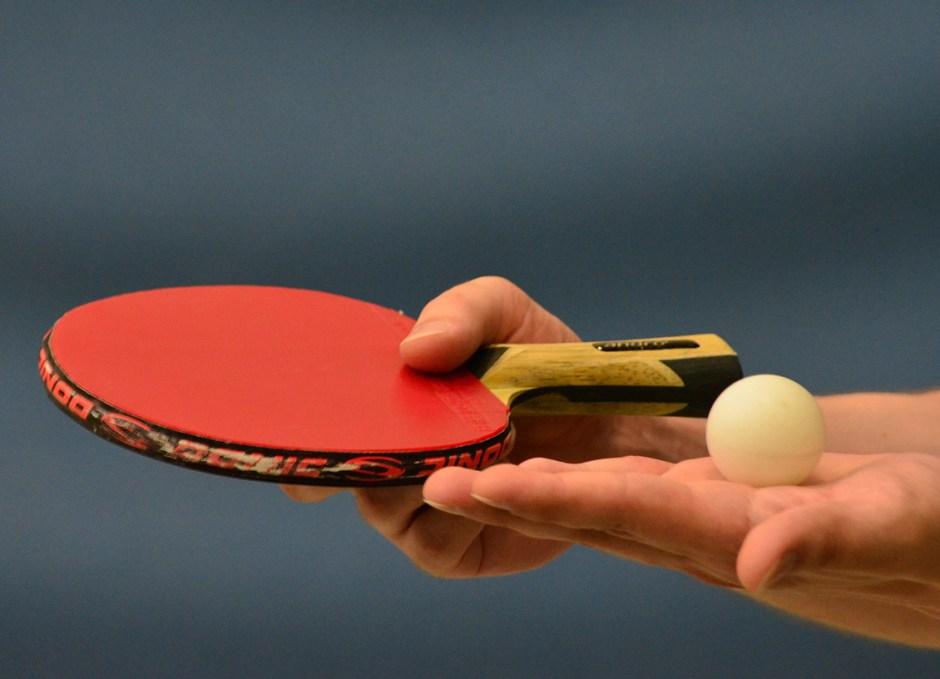 ping pong ball on hand