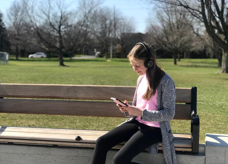 EP-B36 Bluetooth Headphones Lauren on bench