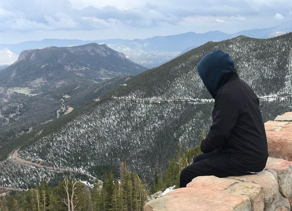 rocky mountain national park guy sitting on rock