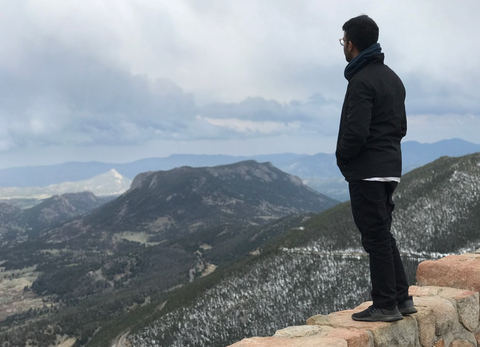 rocky mountain national park guy standing on wall