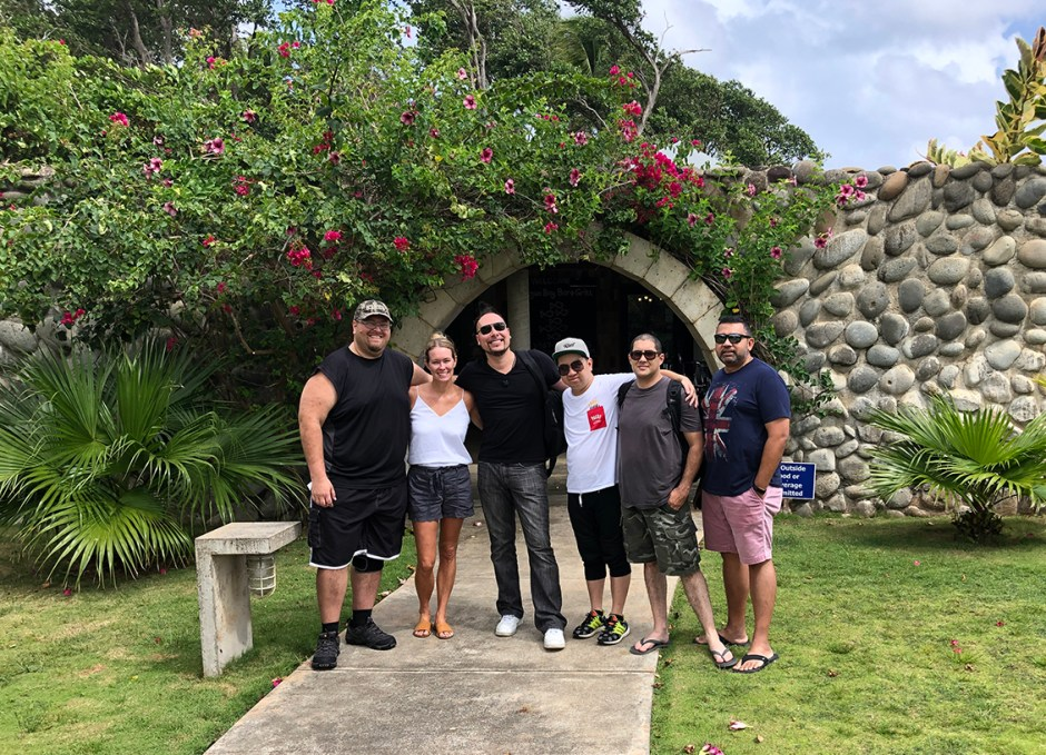 Pagua Bay House group in front of archway