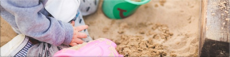 playing in sandpit outdoors