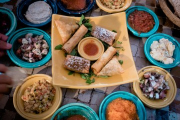 morrocan dinner party spread in colourful bowls