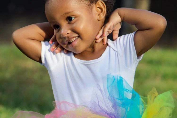 child playing rainbow ball run