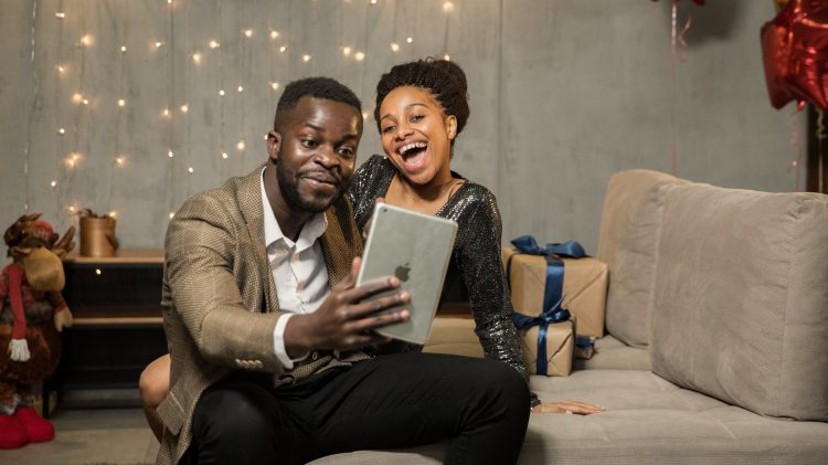 couple holding an ipad playing games