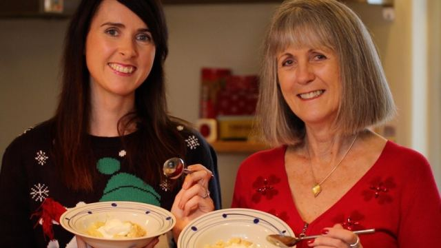 Gemma Stafford with her mom, Patricia Stafford, holding bowls of authentic Irish Apple Crumble.