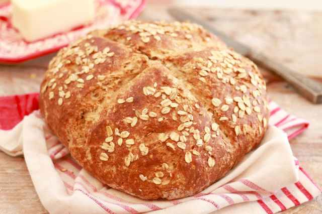 Traditional Irish Soda Bread baked, topped with oats.