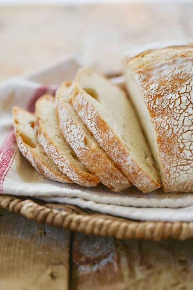 Sliced sourdough bread, showing the crumb on the inside.