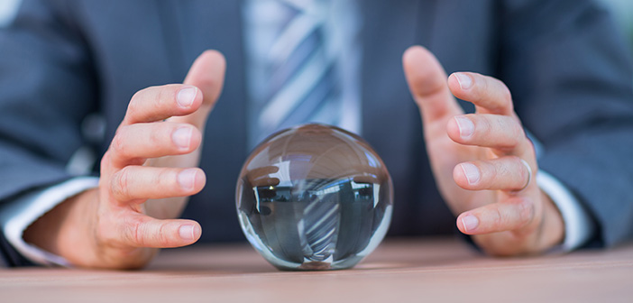 Businessman forecasting a crystal ball