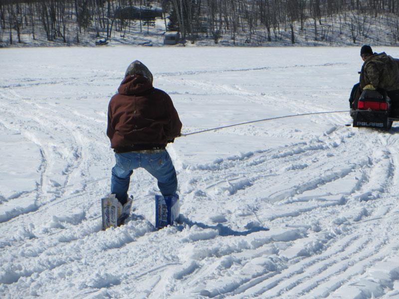 Beer Case Skiing behind snowmobile