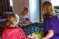 Kids playing fooseball in the apple barn