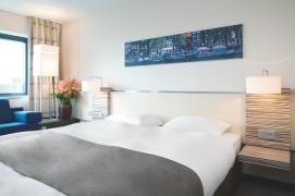 Bijzondere Overnachting Origineel Overnachten Movenpick City Centre Hotel Amsterdam uizicht over Amsterdam2