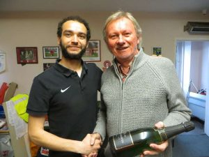 Dave McCourt, right, presents a Harrow Borough player with a man-of-the-match award