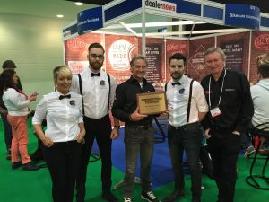 Dave McCourt, far right, celebrates an award with some of his Bikesure colleagues