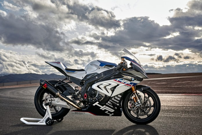 A BMW HP4 sitting in front of rolling clouds