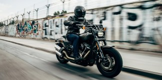 Person riding their motorcycle in full gear including helmet