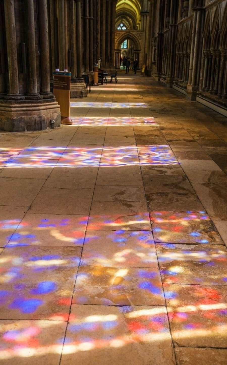 UK lincoln cathedral stained glass colors the floor