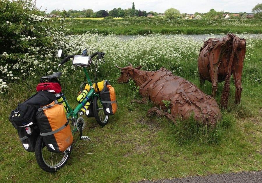 Folding bike meets cow sculptures in the UK