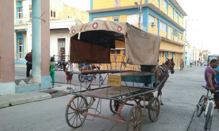 Meeting a horse drawn carriage in Cuba while on a bike tour