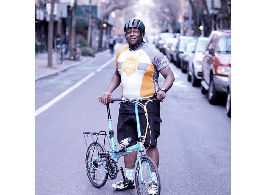 New Yorker in City with Folding Bike Friday