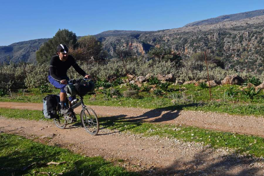 Bike touring on gravel mountain road in Greece