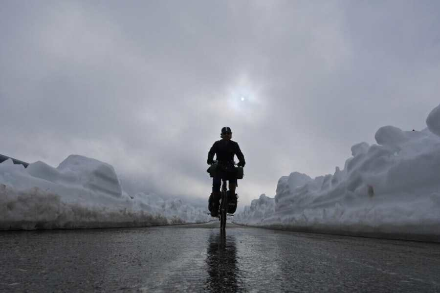 Cycling through snow on an overcast day