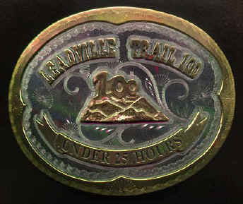 Finishers of the race are awarded belt buckles instead of medals, like the one pictured here.