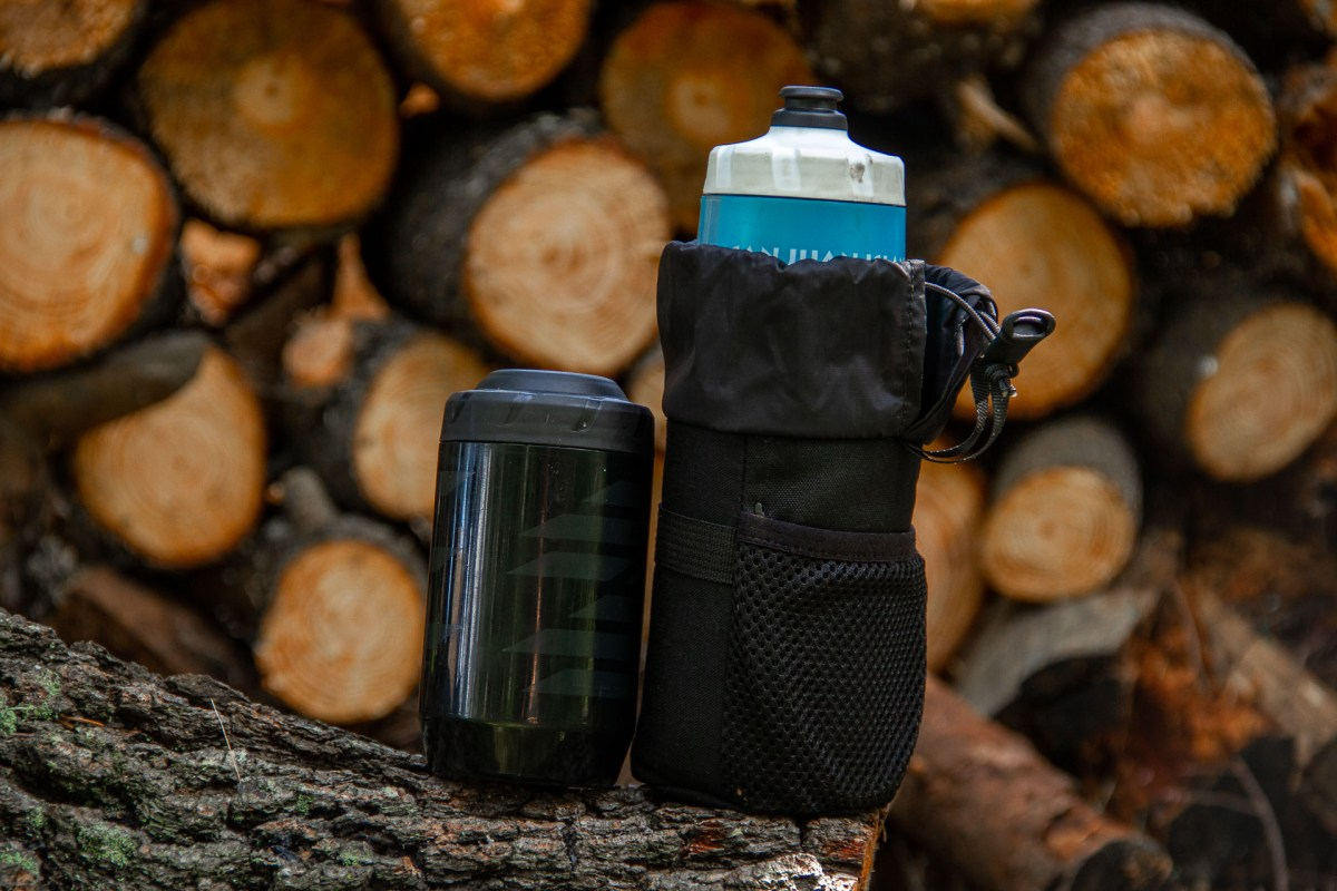 The bottle pouch fits a standard bottle well, or a storage keg. It also fits a tall thermos for cold rides, FYI.