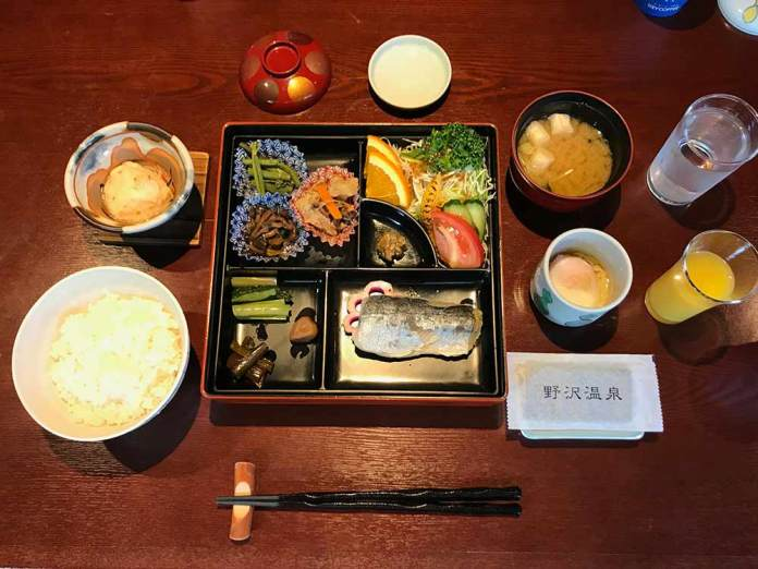 traditional japanese breakfast of fish and vegetables