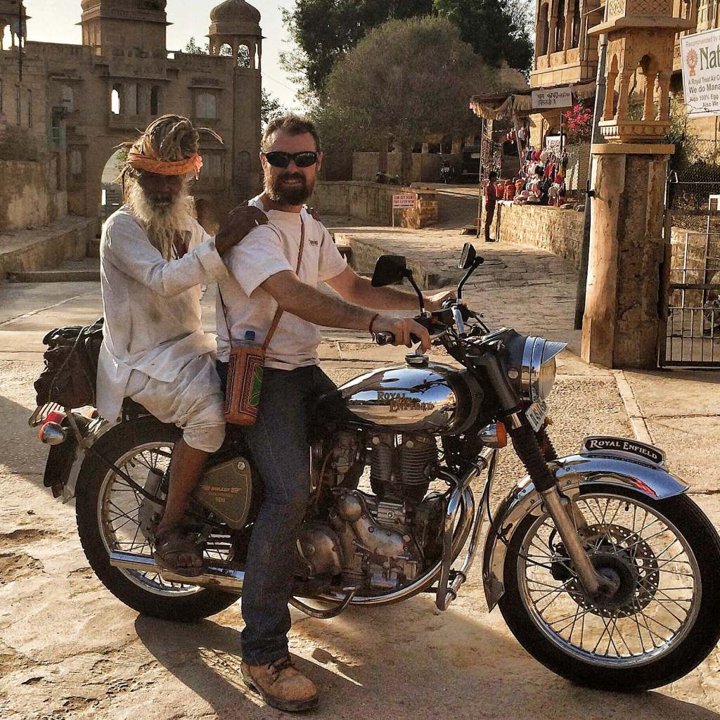 CAPTION: You meet the nicest people on an Enfield. Especially in India. Matt's pillion is a wandering, cannabis-smoking Hindu holy man. Apparently he used to play basketball at an international level for India. Pic courtesy of Nevermind Adventures, 2012.