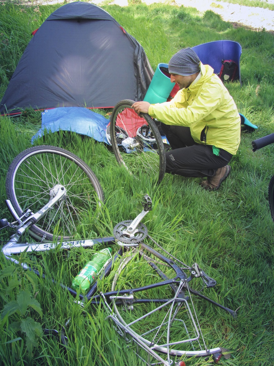 changing flat tire near the tent