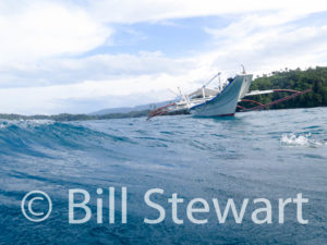 Our bangka boat approaches us for pickup after a dive in Manila Channel, Puerto Galera, Philippines.