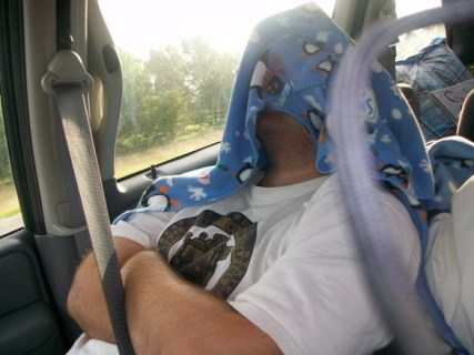 Dad trying to sleep on the way home
