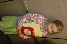 Cute picture of Ada with her book and notebooks (for drawing)