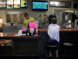 Liam decides to watch a game at the bar. By himself while we swam.