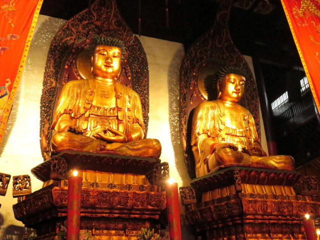 Two of the three Golden Buddhas in the Grand Hall. They were too big to get all 3 in one picture. Jade Buddha Temple, Shanghai, China, Asia.