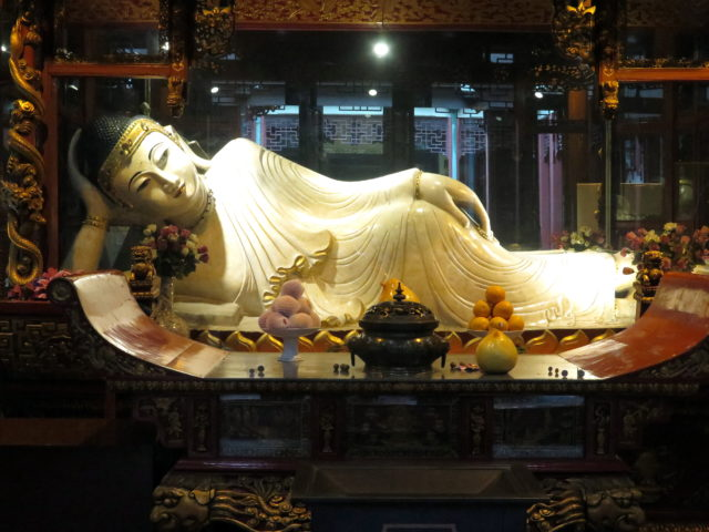 One of the temple's 2 namesake jade Buddhas. This is the jade reclining Buddha. Both jade Buddhas were transported from Burma. No photographs are allowed of the jade seated Buddha, which is 6-feet-tall and gorgeous. Jade Buddha Temple, Shanghai, China, Asia.