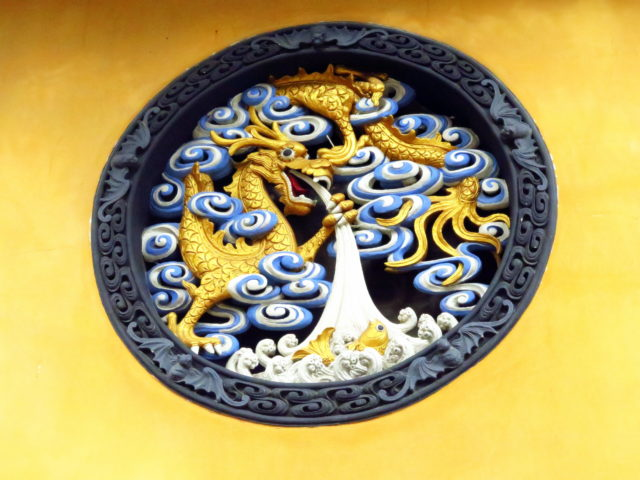 A very cool decoration on the exterior of the Hall of the Four Heavenly Kings. Jade Buddha Temple, Shanghai, China, Asia.