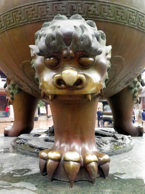 One of the brazier's fantastic feet. Jing'an Temple, Shanghai, China, Asia.