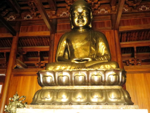 Seated Buddha in the Precious Hall of the Great Hero. Jing'an Temple, Shanghai, China, Asia.
