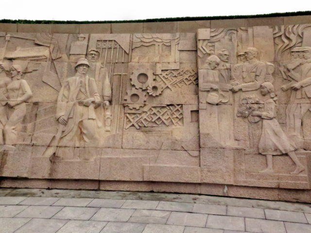 Detail from the large relief of people's heroes. Bund, Shanghai, China, Asia.