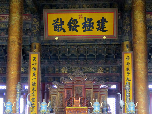 Imperial inscriptions in Chinese characters above and beside the Dragon Throne in the Forbidden City's Hall of Supreme Harmony. Forbidden City, Beijing, China, Asia.