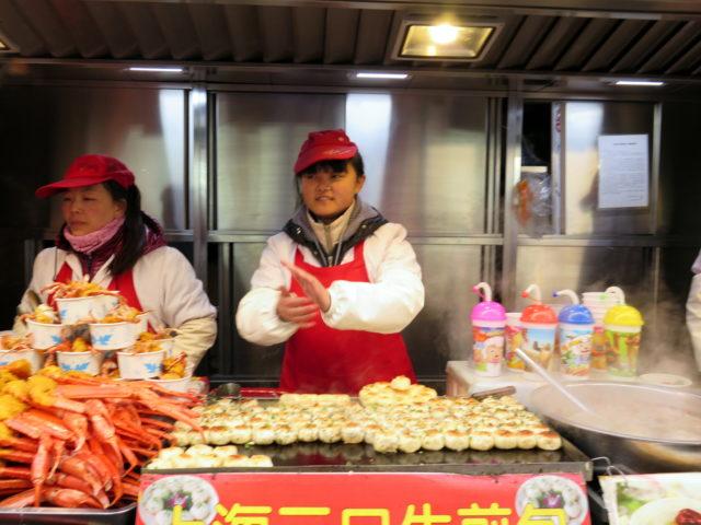 Dumpling merchants in Wangfujing Snack Street, Beijing. China, Asia.