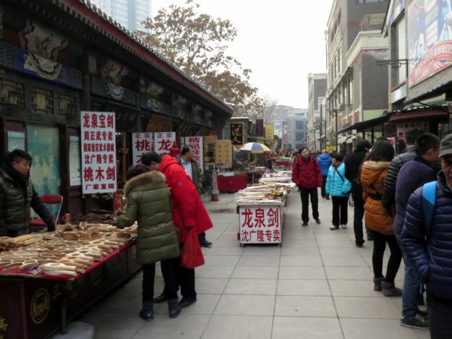 Bargain hunting on Ancient Culture Street. Tianjin, China, Asia.