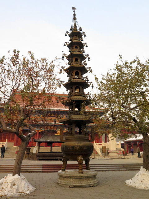 A tall brazier reminiscent of the one at Jing'an Temple in Shanghai. Tianjin, China, Asia.