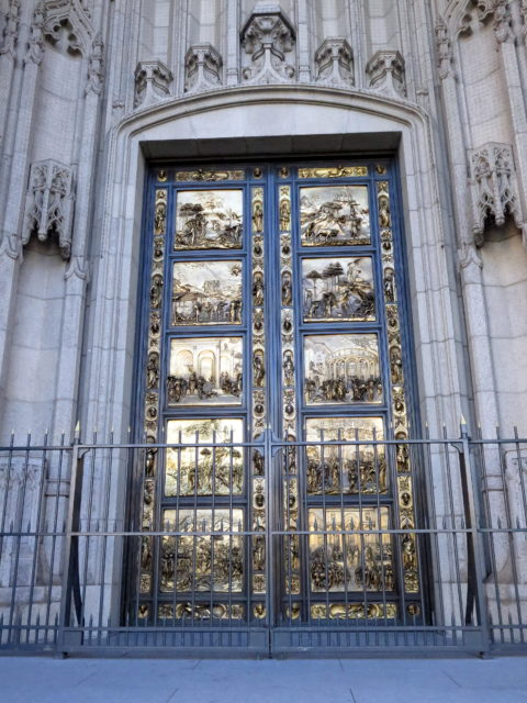 Grace Cathedral's gilded bronze Ghiberti doors. The doors are replicas of basilica doors in Florence known as the Gates of Paradise crafted by Lorenzi Ghiberti in the 15th century. San Francisco, United States, North America.